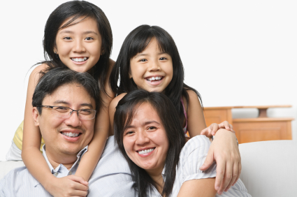 A Picture of Family Happy with our plumbing services. Call us now for a reliale plumber singapore.